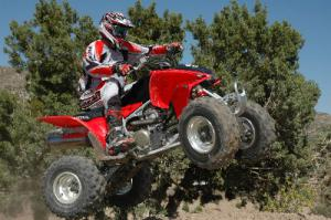 If riding fast and catching air is your goal, a high performance sport ATV such as this Honda Sportrax 450R is what you need.