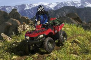 For traversing rocky or hilly terrain, it is critical to go slow and now allow a front wheel to get stuck in a hole.
