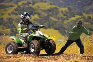 When learning to ride an ATV, beginners should practice in an open, obstacle-free area.