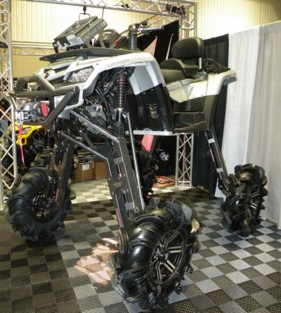 QUAD Magazine's booth was home to this insane mudder. Fitted with enormous Gorilla Axles, this Can-Am Outlander was a sight to behold.