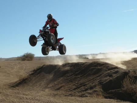 It's easy to get the Outlaw airborne, but it's a little tougher to control than a straight axle ATV.
