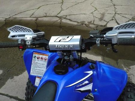 Flexx handlebars are the first things we'd add to any stock sport quad.
