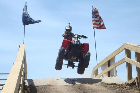 Who says you can�t catch a little air on a 330cc ATV?