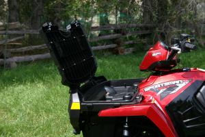 Polaris' opening front rack is the perfect spot to store your tools and other small items.