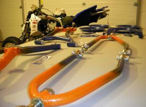 After the engine work, it was time to install a set of ATV Four Play�s MGC MX long-travel front a-arms, which received a trick paint job from Capital Powder Coating in Suffield, Ohio.