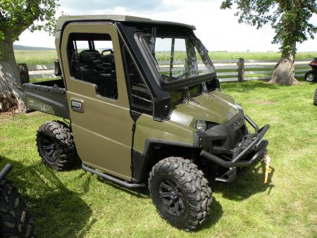 This Ranger XP has been decked out with a new fully enclosed cab featuring roll-down windows.