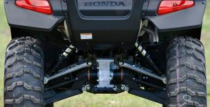 Fully independent suspension offers 10 inches of ground clearance, but the shocks lack preload adjustability.