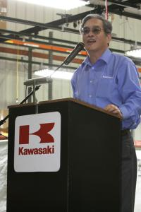 Kawasaki's North American president, Asano Matsuhiro, addresses over 1200 employees and congratulates them on the milestone.