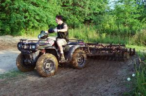 We used a Polaris Sportsman 700 to help haul tools back to the track and pull a disc to groom the soil.