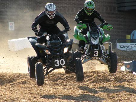 The sport quad racers burned up the mulch track.