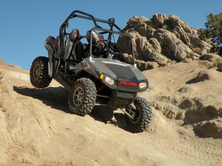 Thanks to its 60-inch width and long-travel suspension, the RZR S is capable of a little rock crawling when you're tired of going fast.