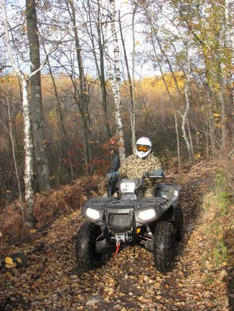 Polaris Sportsman XP handles tight trails or wide corridor trails easily.