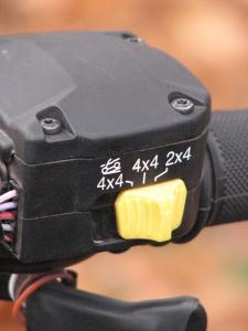 A thumb switch activates Polaris Active Descent Control.