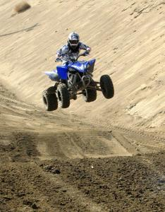 The YFZ450R easily powers over the doubles on the motocross track.