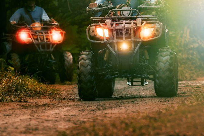 A pair of ATVs on the trail