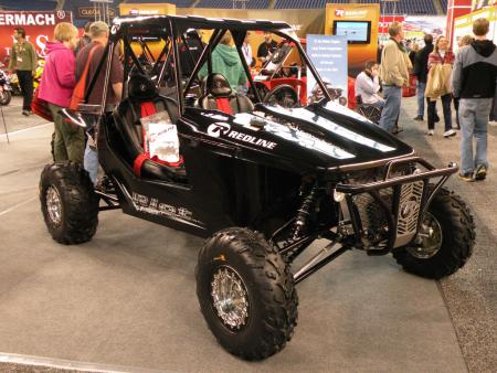 Redline Performance Products built its first two-seat side-by-side, the Riot, and had it on display at Lucas Oil Stadium. It features a 750cc, liquid-cooled, fuel injected, 72 horsepower engine, along with 18 inches of travel up front and 16.5 inches in the rear. We can't wait to get behind the wheel of this one.