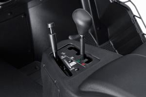 The gear selector and Diff lock are located in the center console.