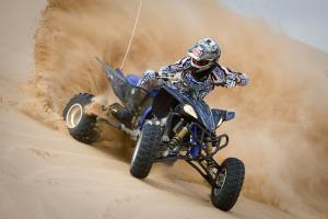 The YFZ's wider stance lends itself to aggressive cornering.