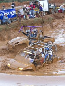 The four-seater on the right plows through the deep and dirty.