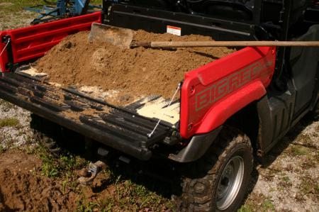 The Big Red's dump box helped us haul in load after load of dirt for our patio.
