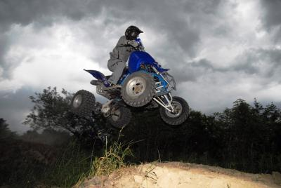 Our author airs out his custom open-class Raptor 660R over a new double on a private motocross track. Hours of behind-the-scenes track maintenance and prep work took place for that lighter-than-air feeling.