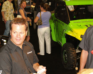 Gordon was a guest at the Polaris dealer meeting last year. Note the tricked out 'Robby Gordon' RZR to the right. Is that the type of thing we can expect from the Polaris/Gordon partnership?