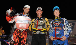 John Natalie (center) is flanked by Chad Wienen (left) and Josh Upperman (right) on the podium.