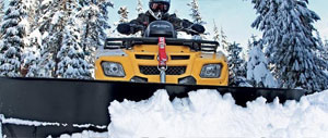 ATV Equipped with Plow