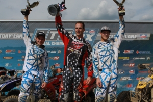 Thomas Brown, Joe Byrd and Chase Snapp celebrate on the podium.