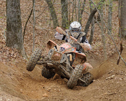 Adam McGill races to a third place finish.