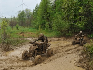 Can-Am riders Chris Bithell and Adam McGill race through the mud.