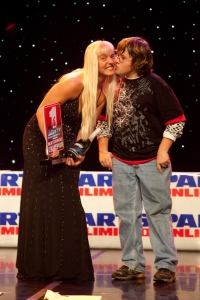 Heather Byrd picks up her award and a gets a kiss.