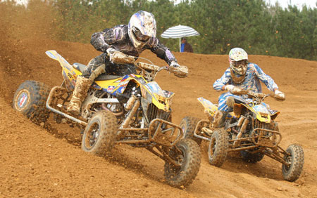 Chad Wienen and John Natalie do battle in the opening round of the AMA ATV Motocross Championship.