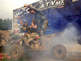 Gust does a burnout on the podium after winning the American Suzuki Summer National.