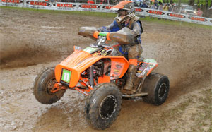 Josh Kirkland sprays some mud at Loretta Lynn's.