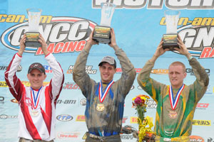 Josh Kirkland hoists the first-place trophy at Power Line Park GNCC.
