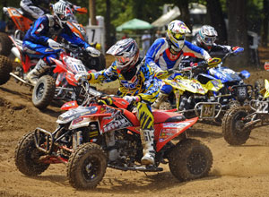 Casey Martin takes a holeshot on his Polaris Outlaw 450 MXR.