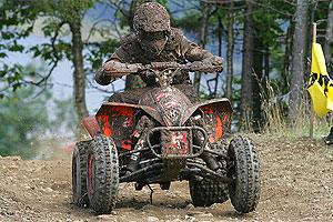 A slightly muddy McGill pilots his KTM to victory.
