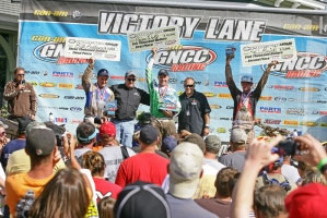 Brian Wolf, Chris Borich and Bill Ballance reap the rewards of a great race.