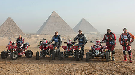 The Polaris team poses in front of the pyramids at the Pharaons Rally in Egypt.