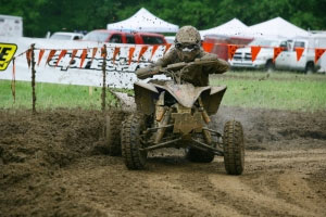 A muddy Brandon Sommers rounds the corner.