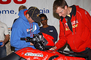 Team Suzuki's Doug Gust and Ryan Cox sign the historic KingQuad 450.