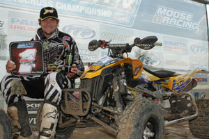Chad Wienen poses beside his Can-Am DS 450.