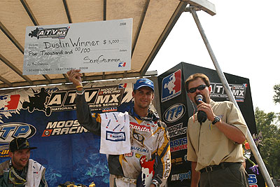 Dustin Wimmer holds a $5,000 check for winning the Riders' Championship.