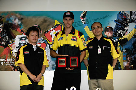 Dustin Wimmer claims his award from Suzuki.