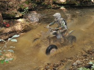 With his machine out of commission, Brian Wolf borrowed a practice bike from another racer and still won the XC2 class.